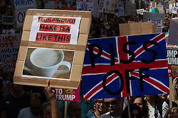 "© Licensed to London News Pictures . 13/07/2018. London, UK. Placard reading "" Trump would make tea like this "" illustrated by a cup of extremely pale, milky tea . Demonstrators march from Portland Place to Trafalgar Square in protest against US President Donald Trump's UK visit . Photo credit: Joel Goodman/LNP"