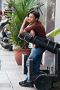 Malaysia, Kuala Lumpur. Bukit Bintang shopping and entertainment district. Yound man with cannon.