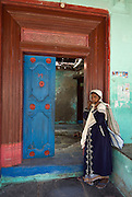 Woman at door to a home in Nagapattinam.