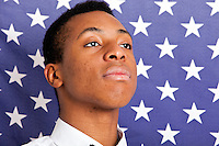 Close-up of young man against American flag