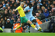 Picture by Paul Chesterton/Focus Images Ltd.  07904 640267.03/12/11.Steve Morison of Norwich and Kolo Touré of Man City in action during the Barclays Premier League match at the Etihad Stadium, Manchester.