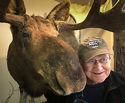 Louis Shoptaugh, a tourist from Springfield, Mo. poses with a taxidermied moose on display at the American Bald Eagle Foundation in Haines, Alaska. <br /> <br /> The American Bald Eagle Foundation, founded in 1982, is a popular tourism attraction. Here tourists can see live raptor demonstrations and interpretive wildlife displays. The foundation also sponsors the Alaska Bald Eagle Festival during the fall for a gathering of bald eagles that is among the largest in the world. The foundation&rsquo;s website says that it is a non-profit foundation &quot;dedicated to the protection and preservation of bald eagle habitat through sponsoring and facilitating educational and research activities.&quot;