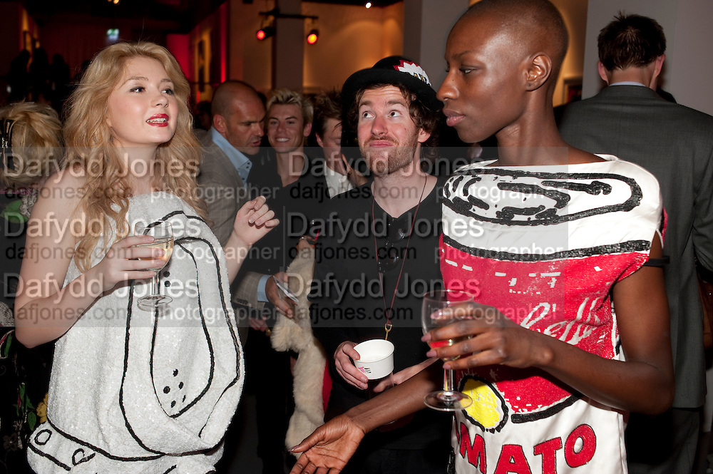 LAURA WINN; PHILIP COLBERT; NALA DIAYOARAYA;  MODELS IN DRESSES DESIGNED BY PHILIP COLBERT , Tunnel of Love. Funfair party The Mending Broken Hearts appeal In aid of the British Heart Foundation. Victoria House, Bloomsbury. London. 17 May 2011. <br /> <br />  , -DO NOT ARCHIVE-© Copyright Photograph by Dafydd Jones. 248 Clapham Rd. London SW9 0PZ. Tel 0207 820 0771. www.dafjones.com.