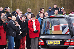 © Licensed to London News Pictures.  04/04/2013. CARTERTON, UK. Friends and family pay their respects during the repatriation ceremony for L Cpl Jamie Webb of 1st Battalion The Mercian Regiment, who died in Afghanistan on March 26.  The repatriation, which occurs through nearby RAF Brize Norton, is the first for 11 weeks. . Photo credit :  Cliff Hide/LNP