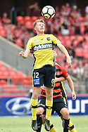 February 12, 2017: Central Coast Mariners forward Trent BUHAGIAR (12) up for the header at Round 19 of the 2017 Hyundai A-League match, between Western Sydney Wanderers and Central Coast Mariners played at Spotless Stadium in Sydney.