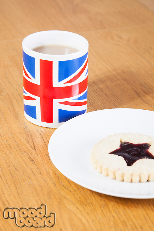 British coffee mug and cookie on plate