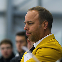 Todd Johnson, Head coach (4th Season) of the Regina Cougars men's hockey team in action during the Men's Hockey Home Opener on October 21 at Co-operators arena. Credit: Arthur Ward/Arthur Images