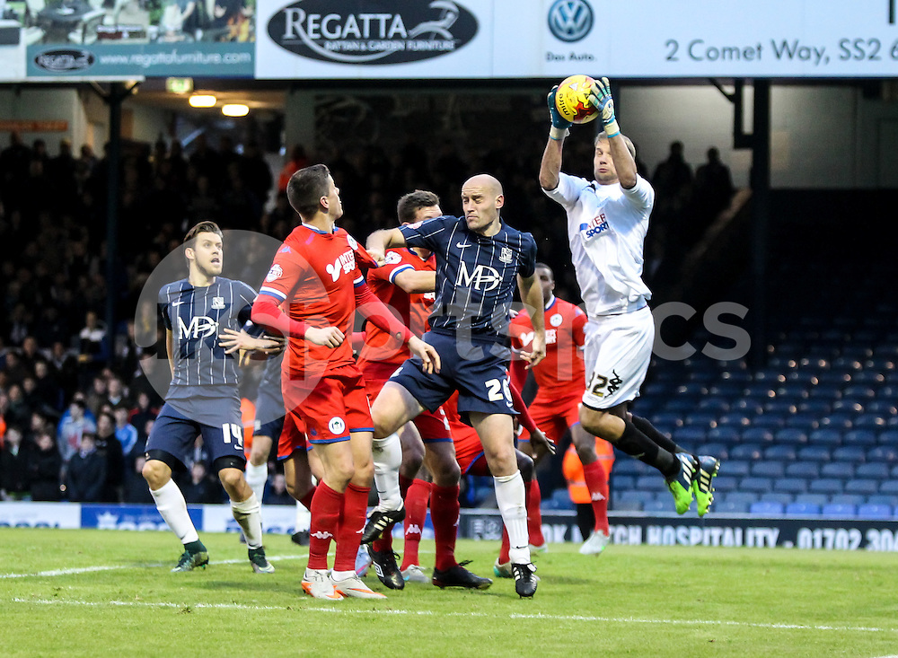 Jussi Jääskeläinen  of Wigan Athletic collects a cross in front of Adam Barrett of Southend United during the Sky Bet League 1 match between Southend United and Wigan Athletic at Roots Hall, Southend, England on the 28th November 2015. Photo by Ken Sparks.