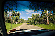 View from car of road through the Daintree Rainforest, Queensland, Australia