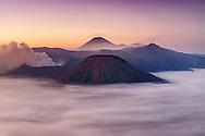 Dawn view of Mount Bromo (near left) and Gunung Semeru (centre background) in Bromo Tengger Semeru National Park, Java, Indonesia.