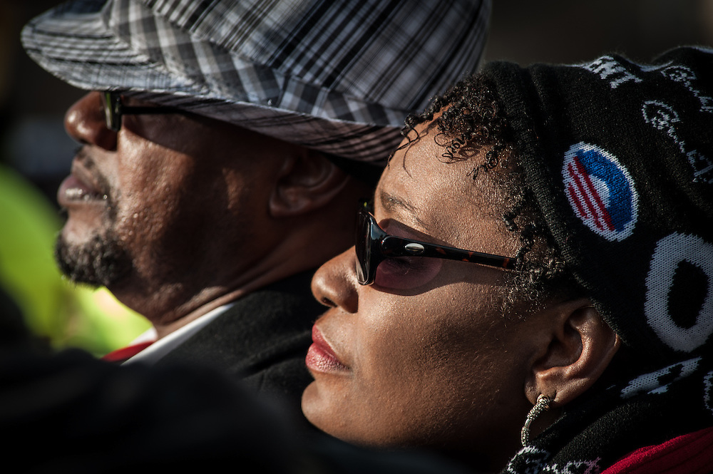WASHINGTON, DC -- 1/21/13 -- From left: Curtis Angelo, Jr., of Lathrop, CA and Tracey (cq) Lovely, of Oakland, CA) watch the program from the Mall... Inaugural events on the National Mall. Spectators gather on the Mall to witness the swearing in.? by André Chung #AC1_5123