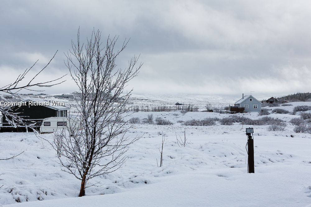 Looking south from the Eyjasol Cottages,  South Iceland, with an incoming snowstorm in the distance.