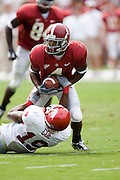 Alabama Crimson Tide wide receiver Tyrone Prothro gets tackled after catching a pass by Arkansas Razorback defensive back Michael Coe during a 24 to 13 win over the Razorbacks on September 24, 2005 at Bryant-Denny Stadium in Tuscaloosa, Alabama..Mandatory Credit: Wesley Hitt/Icon SMI
