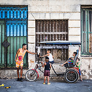 03/11/2017  OLD HAVANA, CUBA    A man asks a group of children to get off his pedicab in Old Havana, Cuba.  (Aram Boghosian for The New Orleans Advocate)
