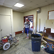 A member of the Boston Cannons walks though a storage room prior to the game at Harvard Stadium on May 17, 2014 in Boston, Massachuttes. (Photo by Elan Kawesch)