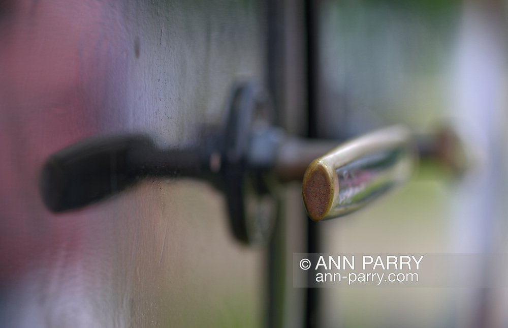 Old Westbury, New York, USA. June 2, 2019. The 1925 Model T Ford passenger side door handles, seen in macro closeup, are at the 53rd Annual Spring Meet Antique Automobile Show, sponsored by the Greater NY Region (NYGR) of the Antique Automobile Club of America (AACA), at Old Westbury Gardens, a Long Island Gold Coast estate. The vintage car, owned by Scott Gramlich, of Baldwin, won two awards - Oldest Car and Best Model T.