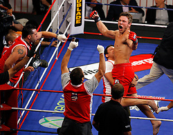 August 2, 2007; East Rutherford, NJ, USA; The Pitbulls Dan Miller (Red Trunks) celebrates choking out the Sabres David Phillips (Blue Trunks) in the first round during their semifinal bout at the Continental Airlines Arena in East Rutherford, NJ.