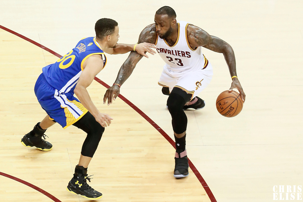 10 June 2016: Golden State Warriors guard Stephen Curry (30) defends on Cleveland Cavaliers forward LeBron James (23) during the Golden State Warriors 108-97 victory over the Cleveland Cavaliers, during Game Four of the 2016 NBA Finals at the Quicken Loans Arena, Cleveland, Ohio, USA.