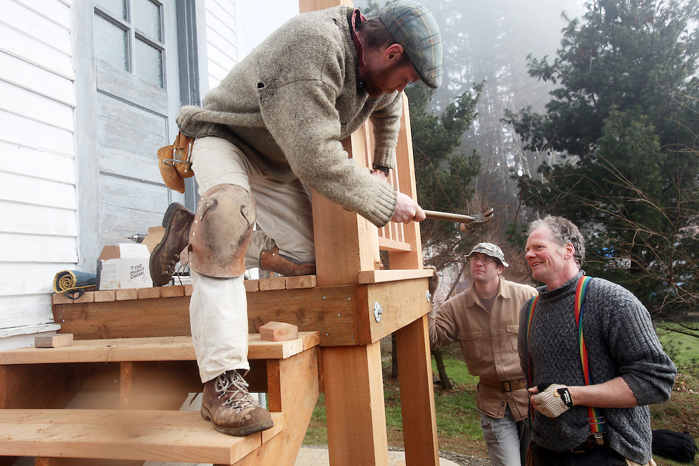 Nate Killops hammers. Clatsop Community College Historic Preservation students, under the supervision of their instructor Lucien Swerdloff and contractor Tim Kennedy, build staircases and railings during a workshop February 5 & 6 to replace the rotted porches on the historic U.S. Columbia River Quarantine Hospital (aka the Pesthouse) in Knappton Cove, Wash., on Sunday, March 6, 2011.