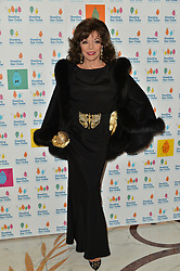 © Licensed to London News Pictures. 30/09/2017. London, UK. DAME JOAN COLLINS attends The Shooting Stars Chase Ball at the Dorchester Hotel. The leading children's hospice cares for babies, children and young people with life-limiting conditions, and their families. The Ball is the charity's flagship event and hopes to raise in excess of £100,000 to provide nursing, medical and emotional support to families going through unimaginable circumstances. Photo credit: Ray Tang/LNP
