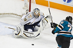 January 8, 2011; San Jose, CA, USA; Nashville Predators goalie Pekka Rinne (35) stops a shot from San Jose Sharks center Benn Ferriero (78) during the first period at HP Pavilion. Mandatory Credit: Jason O. Watson / US PRESSWIRE