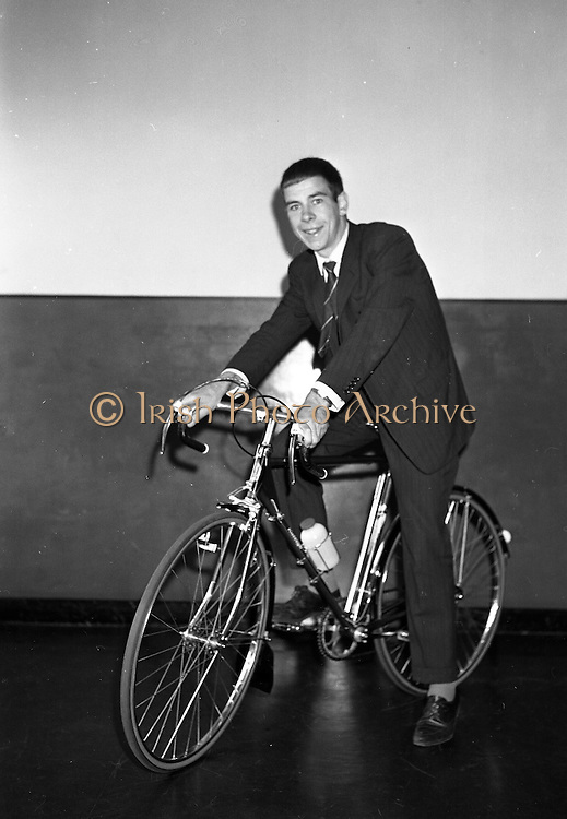 Seamus O'Hanlon, winner of Rás Tailteann, the annual eight day international cycling stage race. 1962. 14.08.1962. 08.14.1962. 14th August 1962. <br /> A presentation of a Raleigh 'Gran Sport' bicycle complete with Capagnolo 10 speed gear system was made to Seamus O'Hanlon, a twenty-year-old Dubliner, who won the Rás Tailteann this year. The presentation was made as he toured the Irish Raleigh Industries factory at Hanover Quay, Dublin.<br /> Picture shows Seamus O'Hanlon astride the bicycle he was presented with during his visit to the Raleigh Factory at Hanover Quay, Dublin.