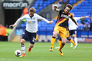 James Henry of Bolton Wanderers tries to make space for a shot under pressure from Bradford City midfielder Romain Vincelot (6) during the EFL Sky Bet League 1 match between Bolton Wanderers and Bradford City at the Macron Stadium, Bolton, England on 24 September 2016. Photo by Simon Brady.