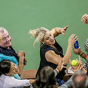 March 15, 2016, Palm Springs, CA:<br /> Fans reach for a stray tennis ball during the 2016 BNP Paribas Open at the Indian Wells Tennis Garden in Indian Wells, California Tuesday, March 15, 2016.<br /> (Photos by Billie Weiss/BNP Paribas Open)