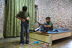 Iraqi refugees Ahmad Thamer, 13, and Hussein Thamer, 8, are seen before the first day of school in Amman, Jordan, Aug. 19, 2007. The family fled the violence in Baquba, Iraq two years ago and are waiting for asylum from the U.N. Refugee Agency so they can finally make a permanent home.
