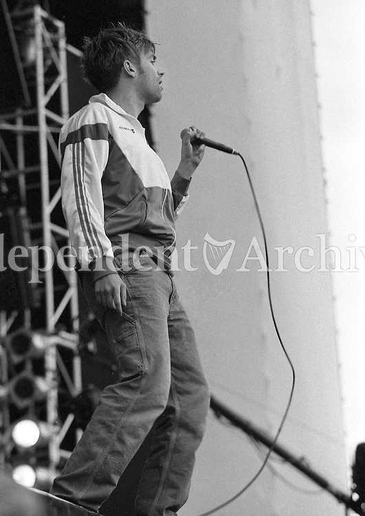 Damon Albarn Lead singer of Blur on stage during the Blur Concert at the RDS, Dublin, 22/06/1996 (Part of the Independent Newspapers Ireland/NLI Collection).