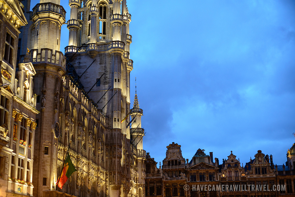 in the Grand Place, Brussels. Originally the city's central market place, the Grand-Place is now a UNESCO World Heritage site. Ornate buildings line the square, including guildhalls, the Brussels Town Hall, and the Breadhouse, and seven cobbelstone streets feed into it.