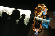 Visitors pass by a clock which stopped at 11.02am, the time of the 9th August 1945 atomic bombing of the city by US Military, in the Nagasaki Atomic Bomb Museum on Tuesday May 24th 2005. Nagasaki, Japan.