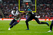 Houston Texans Running Back Duke Johnson (25) runs in for a touchdown during the International Series match between Jacksonville Jaguars and Houston Texans at Wembley Stadium, London, England on 3 November 2019.