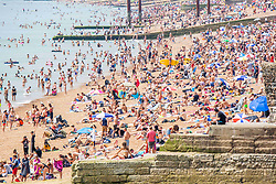 © Licensed to London News Pictures. 07/07/2016. Brighton, UK. Thousands of people take to the beach in Brighton and Hove as sunny and hot weather continues to hit the seaside resort. Photo credit: Hugo Michiels/LNP