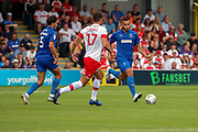 AFC Wimbledon defender Rod McDonald (4) taking on Rotherham United midfielder Matt Crooks (17) during the EFL Sky Bet League 1 match between AFC Wimbledon and Rotherham United at the Cherry Red Records Stadium, Kingston, England on 3 August 2019.