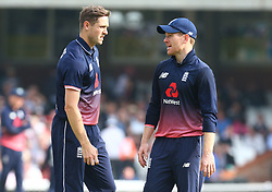 September 27, 2017 - London, England, United Kingdom - L-R England's Chris Woakes  and England's Eoin Morgan .during One Day International Series match between England and West Indies at The Kia Oval, London  on 27 Sept , 2017  (Credit Image: © Kieran Galvin/NurPhoto via ZUMA Press)