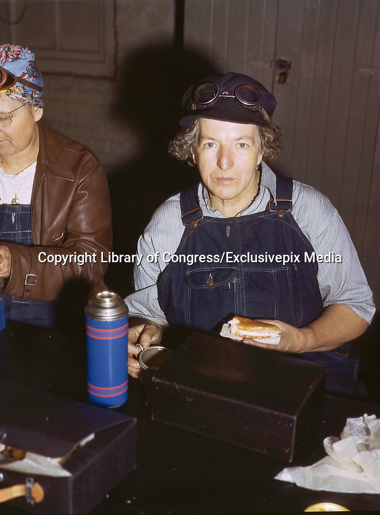 """Fascinating Color Portrait Photos of Women Railroad Workers During WWII<br /> <br /> World War II began when Hitler's army invaded Poland on September 1, 1939. However, it wasn't until the day after the Japanese attacked Pearl Harbor on December 7, 1941, that the United States declared war on the Axis Powers.<br /> <br /> The railroads immediately were called upon to transport troops and equipment heading overseas. Soon the efforts increased to supporting war efforts on two fronts-- in Europe and in the Pacific.<br /> <br /> Prior to the 1940s, the few women employed by the railroads were either advertising models, or were responsible primarily for cleaning and clerical work. Thanks to the war, the number of female railroad employees rose rapidly. By 1945, some 116,000 women were working on railroads. A report that appeared on the 1943 pages of Click Magazine regarding the large number of American women who had stepped forward to see to it that the American railroads continued to deliver the goods during the Second World War:<br /> <br />     """"Nearly 100,000 women, from messengers aged 16 to seasoned railroaders of 55 to 65, are keeping America's wartime trains rolling. So well do they handle their jobs that the railroad companies, once opposed to hiring any women, are adding others as fast as they can get them...""""<br /> <br /> In April 1943, Office of War Information photographer Jack Delano photographed the women of the Chicago & North Western Railroad roundhouse in Clinton, Iowa, as they kept the hulking engines cleaned, lubricated and ready to support the war effort.<br /> <br /> Photo shows: Mrs. Elibia Siematter on her lunch break.<br /> ©Library of Congress/Exclusivepix Media"""