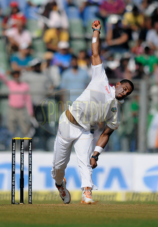 Shannon Gabriel of West Indies bowls during day one of the second Star Sports test match between India and The West Indies held at The Wankhede Stadium in Mumbai, India on the 14th November 2013<br /> <br /> This test match is the 200th test match for Sachin Tendulkar and his last for India.  After a career spanning more than 24yrs Sachin is retiring from cricket and this test match is his last appearance on the field of play.<br /> <br /> Photo by: Pal PIllai - BCCI - SPORTZPICS<br /> <br /> Use of this image is subject to the terms and conditions as outlined by the BCCI. These terms can be found by following this link:<br /> <br /> http://sportzpics.photoshelter.com/gallery/BCCI-Image-Terms/G0000ahUVIIEBQ84/C0000whs75.ajndY