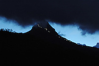 """Sri Lanka, Dalhousie, 2006. At twilight, the pilgrim trail to the 2,243 meter summit of Sri Pada, or the """"sacred footprint,"""" is clearly visible from Dalhousie."""