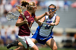 Duke Blue Devils D Christina Germinario (32) defends Virginia Tech Hokies M Rachel Culp (5).  The #3 seeded Duke Blue Devils defeated the #6 seeded Virginia Tech Hokies 19-6 in the first round of the 2008 Women's ACC Lacrosse Tournament held at the University of Virginia's Scott Stadium in Charlottesville, VA on April 24, 2008.