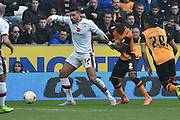 Milton Keynes Dons forward Daniel Powell(17) and Hull City midfielder Moses Odubajo (2)during the Sky Bet Championship match between Hull City and Milton Keynes Dons at the KC Stadium, Kingston upon Hull, England on 12 March 2016. Photo by Ian Lyall.