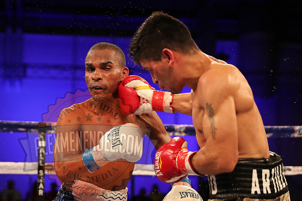 """Jonathan """"Bomba"""" Gonzalez gets punched by Julian """"El Nino Artillero"""" Yedras during a Telemundo boxing match for the WBO Latino Flyweight Title at Osceola Heritage Park on Friday, July 20, 2018 in Kissimmee, Florida.  (Alex Menendez via AP)"""