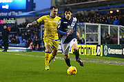 Sheffield Wednesday midfielder Ross Wallace (33) closes in on Birmingham City midfielder Diego Fabbrini (7) during the Sky Bet Championship match between Birmingham City and Sheffield Wednesday at St Andrews, Birmingham, England on 6 February 2016. Photo by Jon Hobley.