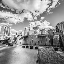 Charlotte North Carolina black and white photo at Romare Bearden Park with clouds. Includes One Wells Fargo Center, Two Wells Fargo Center, Bank of America Corporate Center, Bank of America Plaza, 121 West Trade building, The Vue, and Carillon Tower. Charlotte, North Carolina is a major city in the Eastern United States of America