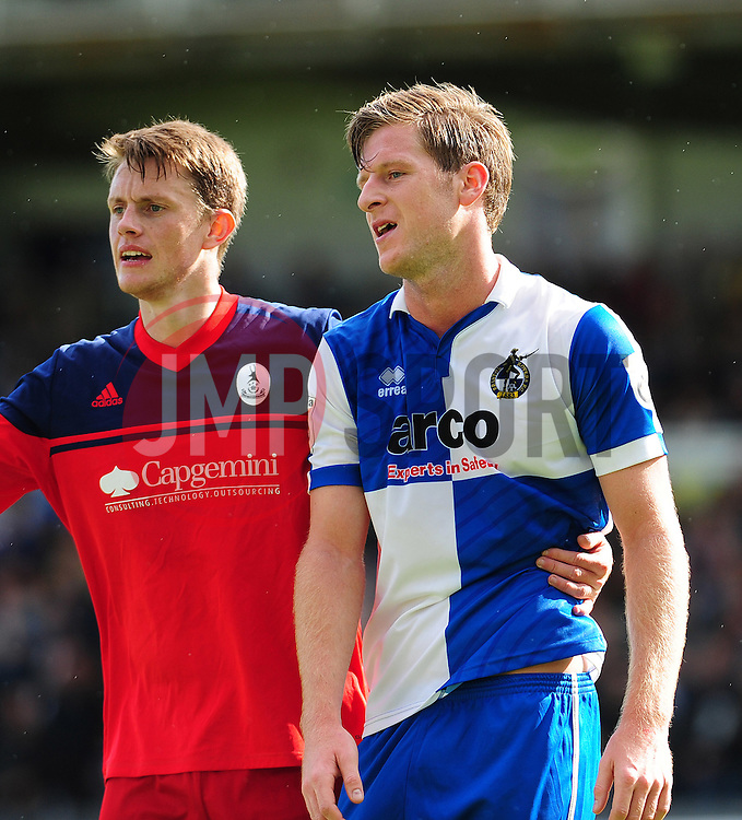 AFC Telford's Steve Akrigg with Bristol Rovers' Adam Cunnington  - Photo mandatory by-line: Neil Brookman - Mobile: 07966 386802 23/08/2014 - SPORT - FOOTBALL - Bristol - Memorial Stadium - Bristol Rovers v AFC Telford - Vanarama Football Conference