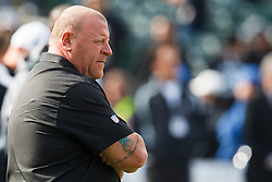 November 28, 2010; Oakland, CA, USA;  Oakland Raiders head coach Tom Cable watches his team warm up before the game against the Miami Dolphins at Oakland-Alameda County Coliseum. Miami defeated Oakland 33-17.