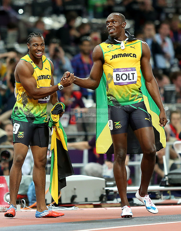Usain Bolt of Jamaica celebrates with Yohan Blake of Jamaica after the 100m final during track and field at the Olympic Stadium during day 9 of the London Olympic Games in London, England, United Kingdom on August 3, 2012..(Jed Jacobsohn/for The New York Times)..