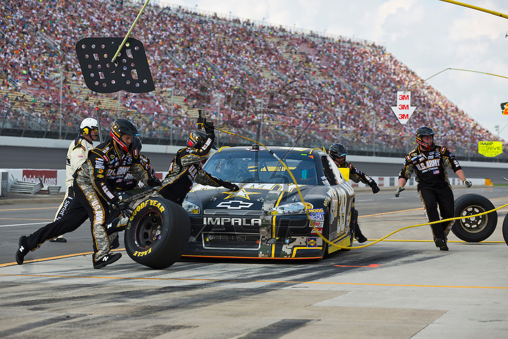 BROOKLYN, MI - JUN 17, 2012:  Ryan Newman (39) brings in his US Army Chevrolet for service during the Quicken Loans 400 at the Michigan International Speedway in Brooklyn, MI.