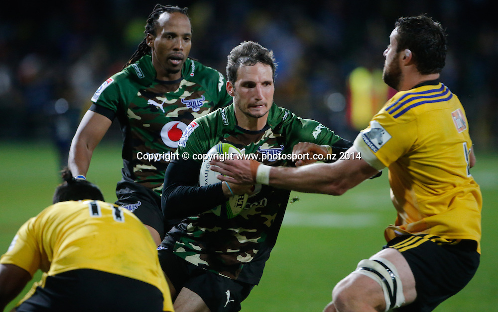 Bull's Jurgen Visser fends a tackle during the Super Rugby match, Hurricanes v Bulls, McLean Park, Napier, New Zealand. Saturday, 05 April, 2014. Photo: John Cowpland / photosport.co.nz
