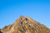 Top of Mount Stuart against blue sky at sunset Central Cascades Washington USA.